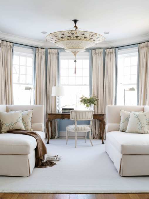 With its pale blue walls and plush cream wool chaises, the sitting area in the master suite is an oasis of calm.