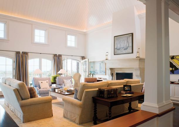 V-groove ceilings and up-lit cove lighting bring intimacy to the large living room.
