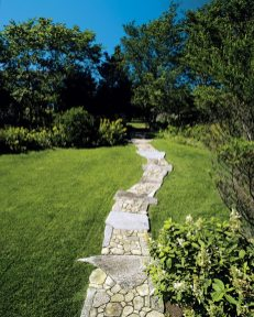 Granite and flat fieldstone shape a gently curving walkway.