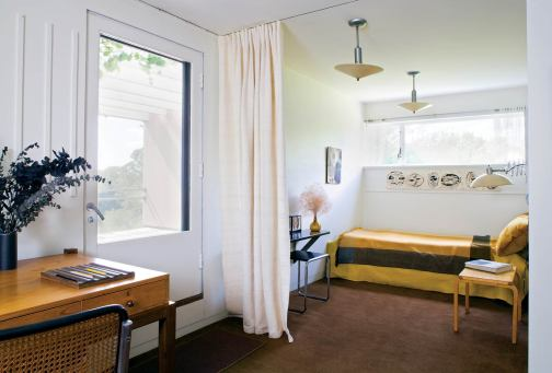 Daughter Ati's bedroom features a private entry and adjoining roof deck.