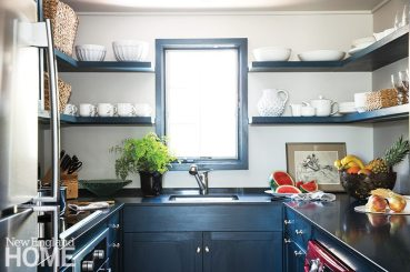 The galley kitchen is compact but efficient; open shelving creates a sense of space and all cabinets are tucked beneath the counters.