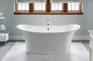 Bathroom with freestanding bathtub and neutral tile