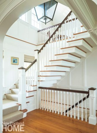 A custom lantern based on an eighteenth-century design is a striking contrast to the modern staircase.