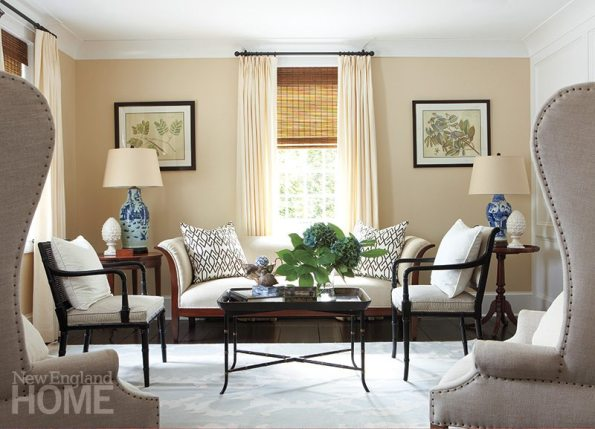 The living room is a comfortable mix of antiques, vintage pieces, and new furniture like the wing chairs from Restoration Hardware.