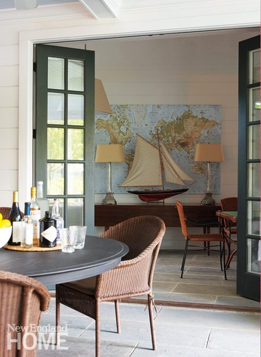 Bi-fold French doors between the game room and the covered porch let cooling breezes flow through the house.