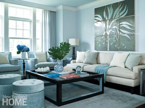 A variety of fine fabrics (Kravet, Brentano, Robert Allen, and Osborne & Little) coexist happily in a living room awash in tones of soft gray and silvery blue. Artwork, hand-blown glass pebble lamps by Porta Romana, and a few well-chosen beachy touches add a casual vibe.