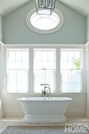 "Simple sheers at the windows give the spacious master bath privacy. ""There's something about a summer breeze gently moving sheers that says relax and take it easy for me,"" says Gauthier."