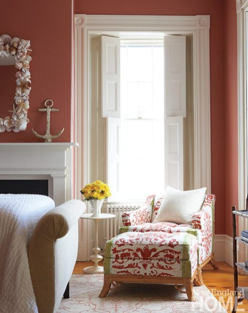 Barnes commissioned the shell-framed mirror, by Laurette Kittle, to play off the terracotta walls and white trim of the master bedroom.