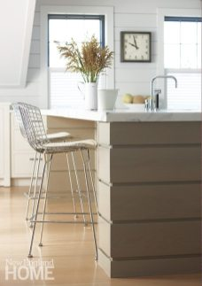 Contemporary wire-backed barstools belly up to the kitchen island.