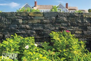 A Connecticut white-line fieldstone wall appears dry-laid from the front, but it's mortared in back for stability.