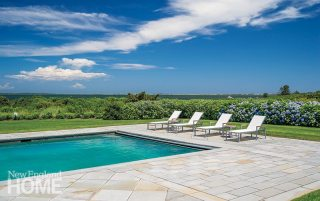 This view from the pool illustrates how the backyard was designed to play off the center of the house.