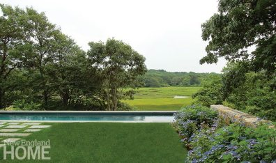 "A pool Kimberly Mercurio designed sits higher than the neighboring marsh to extend the views. ""It's beautiful,"" says -Mercurio. ""There's plenty of wildlife on a daily basis."""