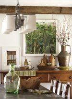 Gentle wood patinas and the colors of nature suit the dining room.