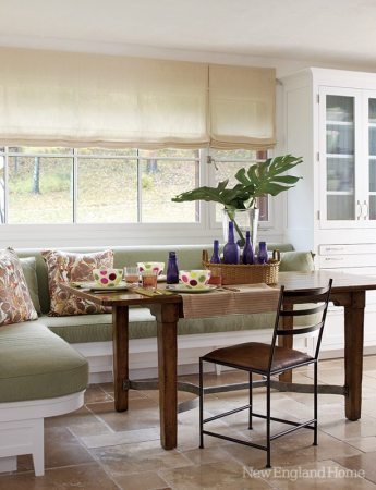 A built-in kitchen alcove repeats the colors and patinas found throughout the house.