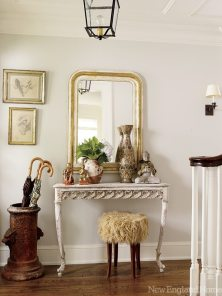 The entry, displaying just a few of the objects the homeowner has collected over the years, hints at the easy comfort of the house.