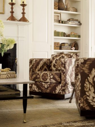 The ikat-covered lounge chairs swivel.