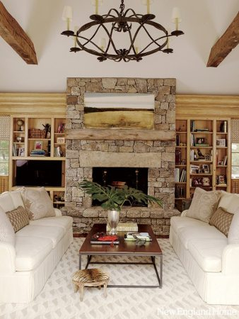 Designer Karen Quinn created an intimate sitting area focused on the spacious family room's stone fireplace. The palette takes its cue from the honey-toned paneling.