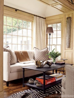 Light spills in on a second, smaller sitting area in the family room.