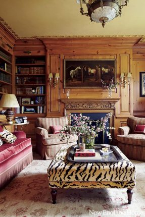 The paneled library is classically styled, with both masculine and feminine touches.