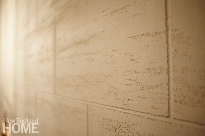 Faux travertine is created by dragging marble chips across the surface when the final plaster coat is applied.