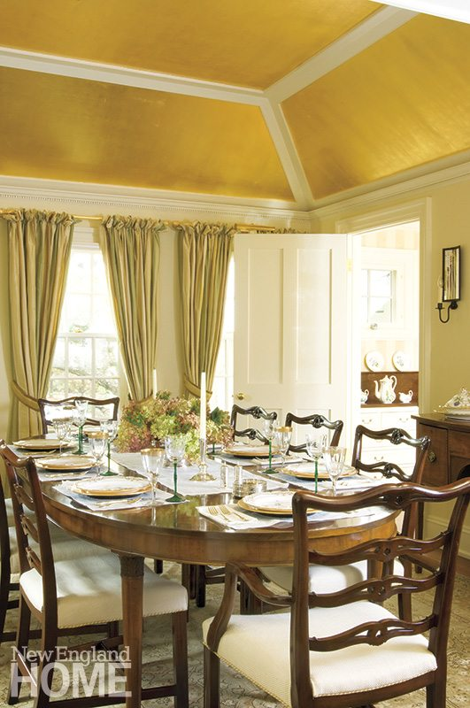 Softly distressed gold leaf draws the eye up to the tray ceiling and reflects light in an otherwise dark space.