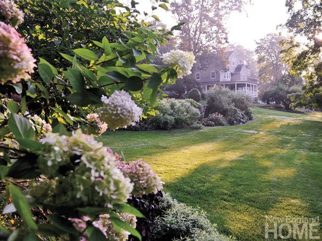 Myriad flowering shrubs conjure a romantic ambience and complement the Victorian home.