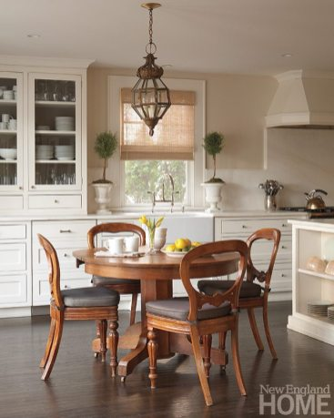 The designer uses color judiciously, opting for a kitchen with clean lines and a subtle palette.