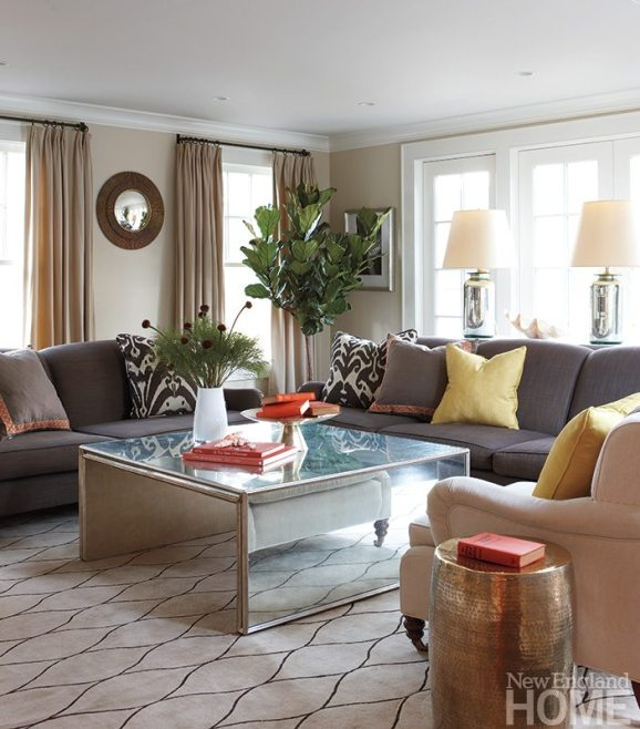 The family room is in the new addition at the rear of the house. Reflective surfaces in the coffee table, side tables and lamps spark a room that's all about comfort. Soft neutral tones and traditionally designed furniture promote relaxation.