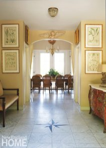 A glimpse of the gracious dining room invites guests in from the foyer.