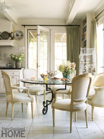 The iron-and-glass kitchen table is a family heirloom.
