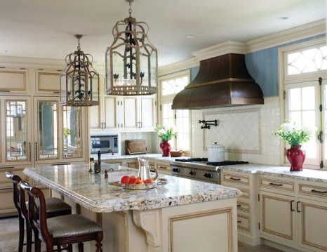 Decorative lanterns and a copper hood boost the kitchen's charm.