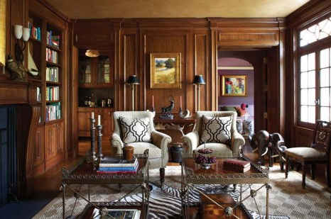 The paneled library exudes a masculine tone.