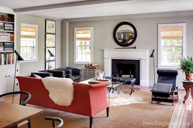 A convex mirror makes an interesting focal point above the great room's fireplace. The refurbished 1940s sofa is by Danish designer Frits Henningsen.