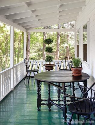 Manicured topiaries suit the tidy porch.