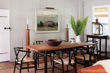 Roch swapped the dining table's glass top for one of handsome elm.