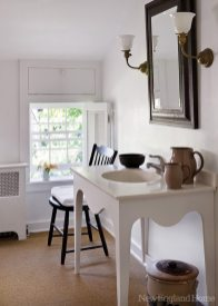 Homeowner Richard Campbell fashioned the bath's sconces from found parts.