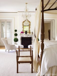 The master bedroom offers several perches for relaxation in addition to the mahogany four-poster bed.
