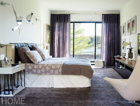 The luxurious master bedroom has views of the lake and the inner courtyard.