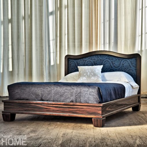 The curvaceous Bed no. Sixteen features a dark maple frame and fetching embroidered headboard detailing in sea blue.