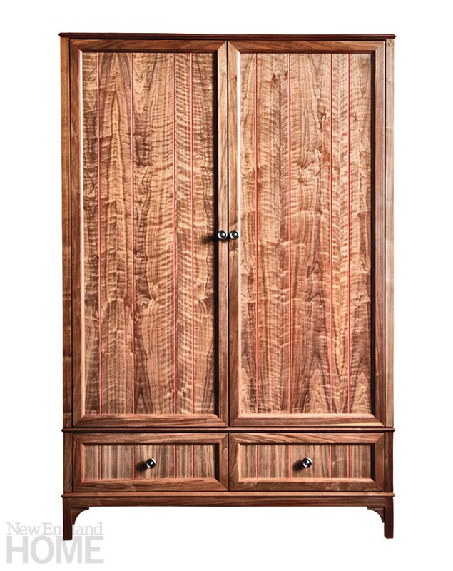 The generously scaled Armoire no. One Fourteen is made of black walnut with a red groove pinstripe.
