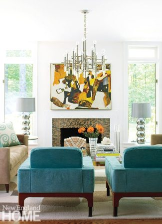 The lack of curtains lets the view be part of the living room's decor no matter the season.