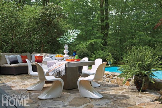 The stone patio Davies built by the existing pool looks as though it's always been there. She gave it a contemporary attitude with a cement table from CB2 and classic Verner Panton chairs.