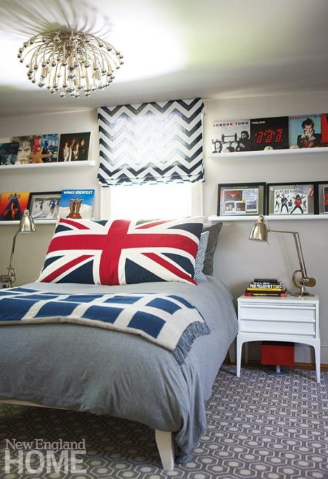 Son Jesse's bedroom recalls the early 1970s and the heyday of rock and roll, with its bold graphic patterns and picture rails holding vintage albums.
