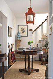 An antique table anchors the entry. The bar table is from Lillian August.