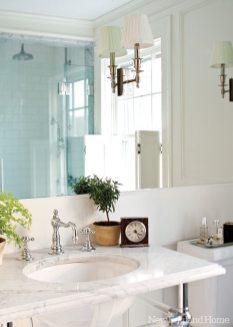 Waterworks fixtures dress up the gentlemanly master bathroom.