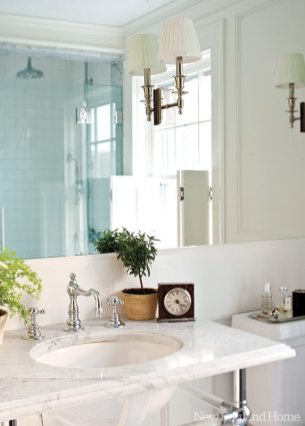 Waterworks fixtures dress up the gentlemanly master bathroom.