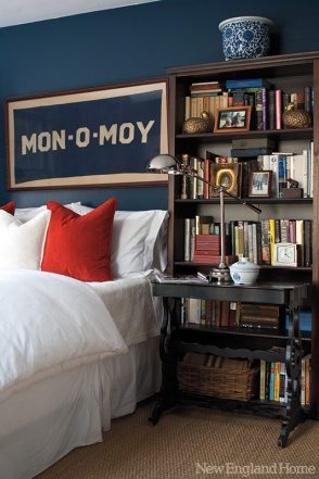 In the master bedroom, a framed banner unearthed at a tag sale recalls days spent on the Cape. Shelves burst with books and antique night tables keep essentials at hand. Restoration Hardware's Frette linens and Ralph Lauren custom pillows cozy things up.