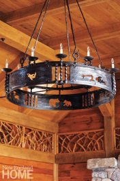 Outdoorsy details, such as the custom-made chandelier in the great room and the ornate legs of the dining table, abound throughout the house.