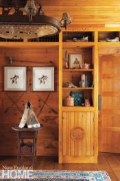 The bookcase, created by Thomas Sippel, blends perfectly with the homeowners' collection of Native American objects.