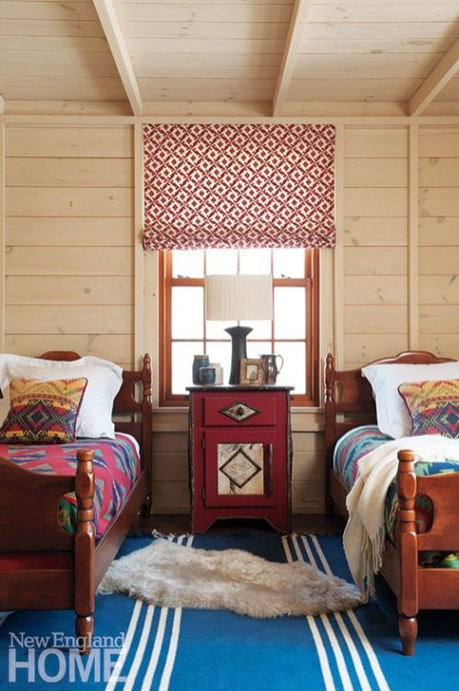 Architect Reese Owens designed the walls of a children's room to look like the inside of a cabin.